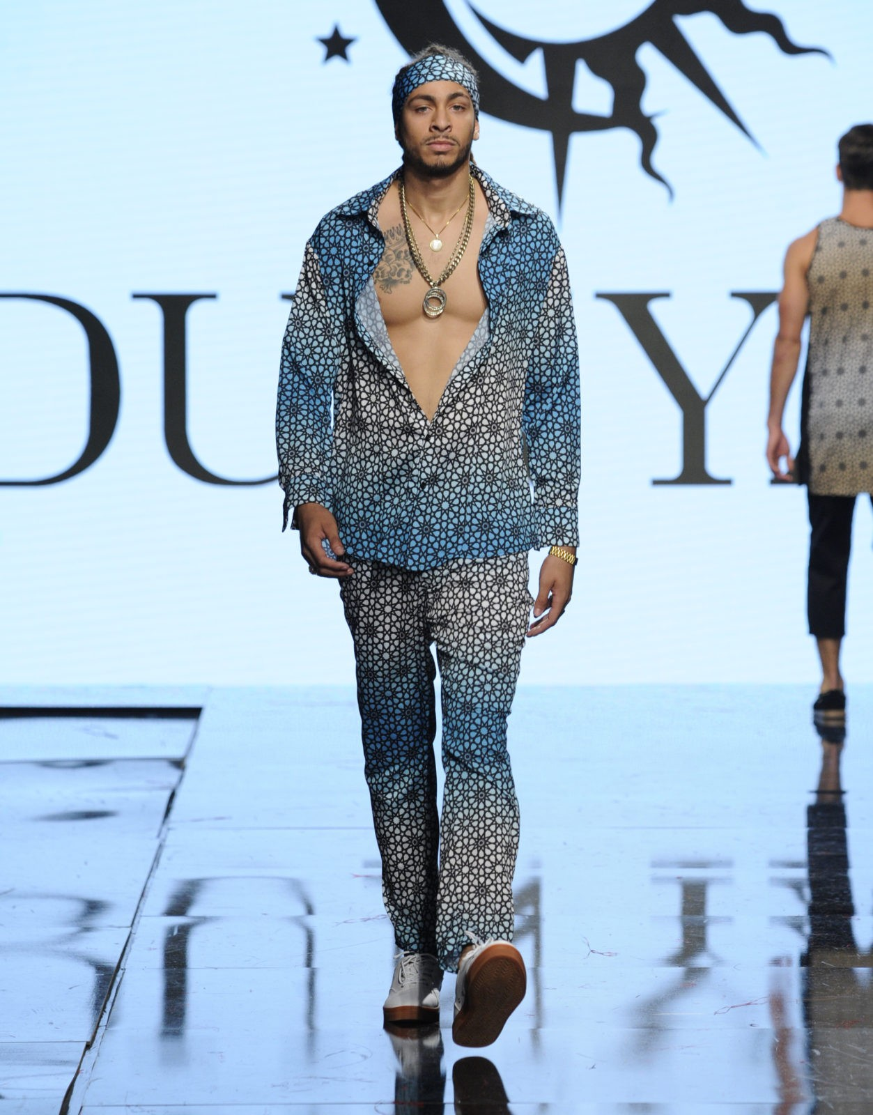 LOS ANGELES, CA - OCTOBER 11:  A model walks the runway wearing Dunyah at Art Hearts Fashion Los Angeles Fashion Week presented by AIDS Healthcare Foundation on October 11, 2016 in Los Angeles, California.  (Photo by Arun Nevader/Getty Images for Art Hearts Fashion)